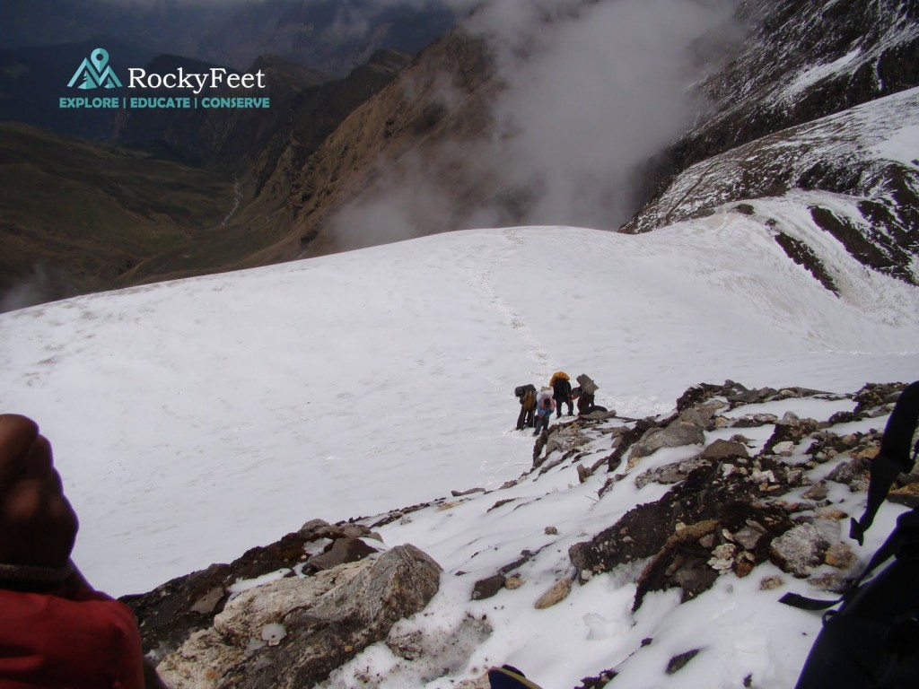 Climbing steep Junargali col through soft snow and loose rotten rock. Had to use rope.